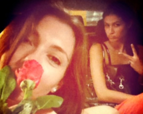 selfie with rose and friend