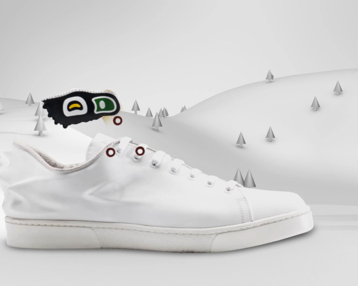 white sneaker with mountains