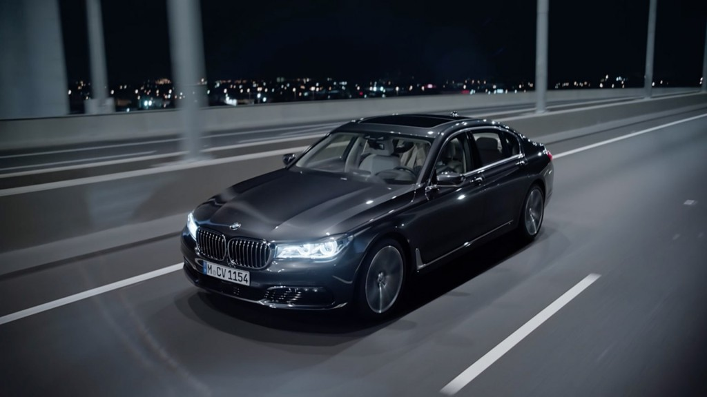 bmw 7 series car driving over bridge